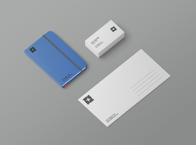 Maqueta estacionaria con tarjeta de visita, cuaderno y postal