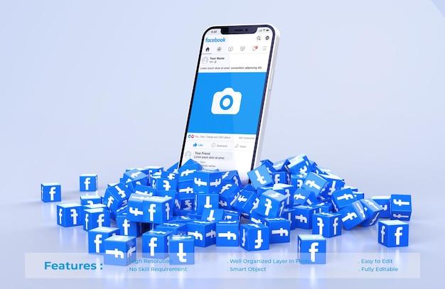 Maqueta de facebook en teléfono móvil con pila dispersa de cubos icono facebook