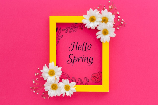 Maqueta flat lay de marco con flores de primavera