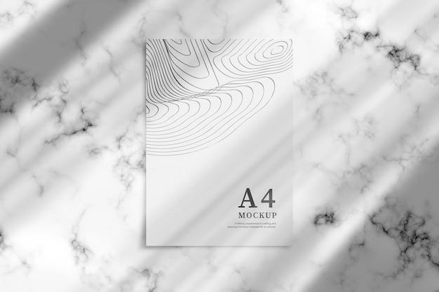 Maqueta de foto de póster a4 en piso de mable