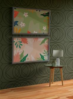 Maqueta gris minimalista de cuadros colgada en la pared