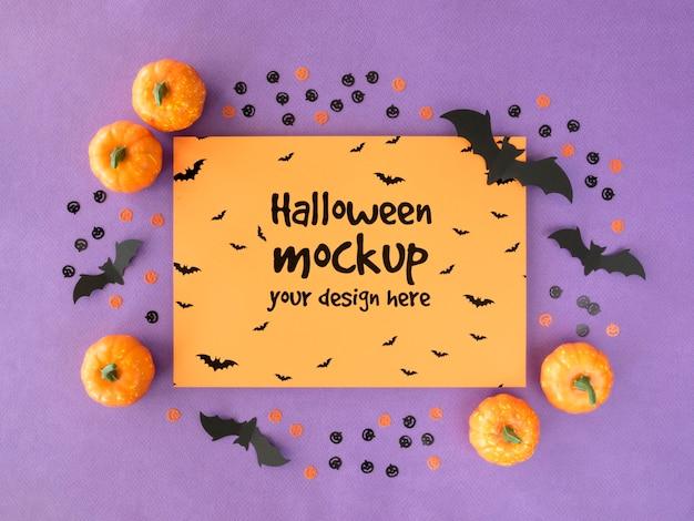 Maqueta de halloween con calabazas y murciélagos.