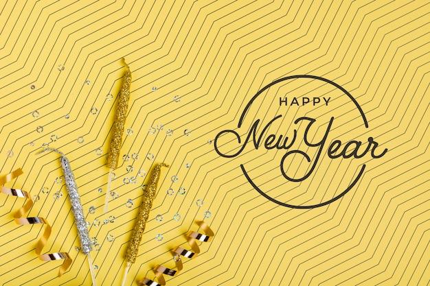 Maqueta de letras de año nuevo sobre fondo amarillo