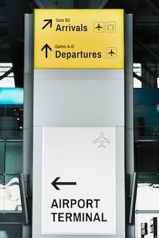 Maqueta de letrero blanco y amarillo.