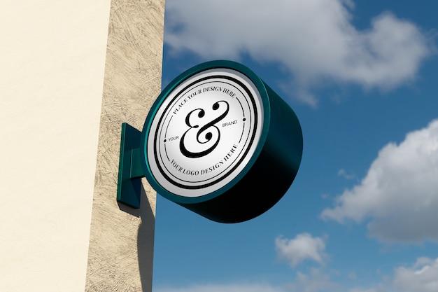 Maqueta de letrero de logotipo moderno letrero redondo circular en el exterior con cielo azul