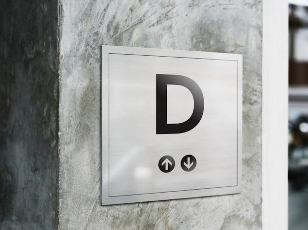 Maqueta de letrero en una pared de estilo industrial