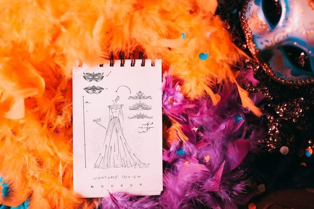 Maqueta de libreta con concepto de carnaval