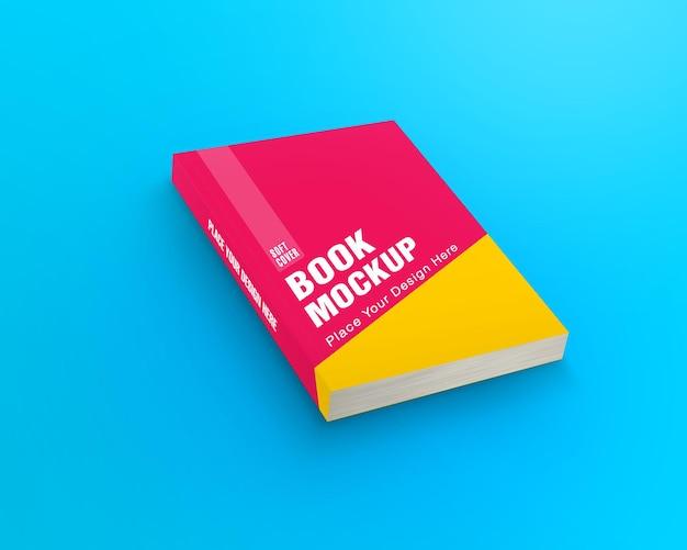 Maqueta de libro de tapa blanda aislado sobre fondo azul.