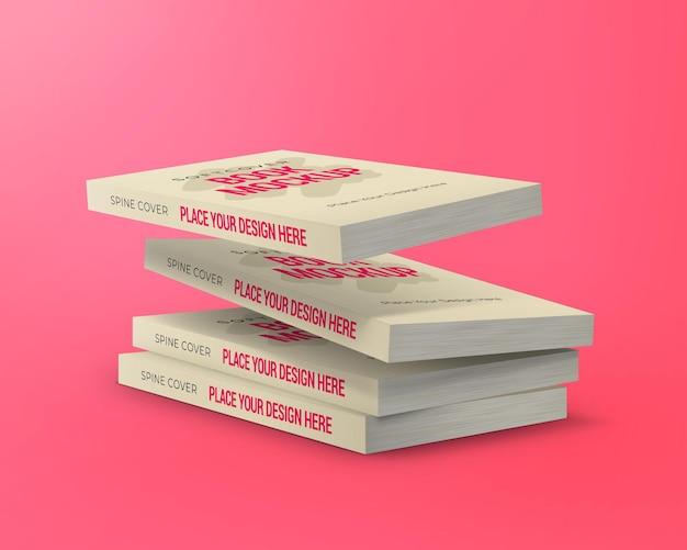 Maqueta de libro de tapa blanda pilas de libros flotantes aislados sobre fondo rosa