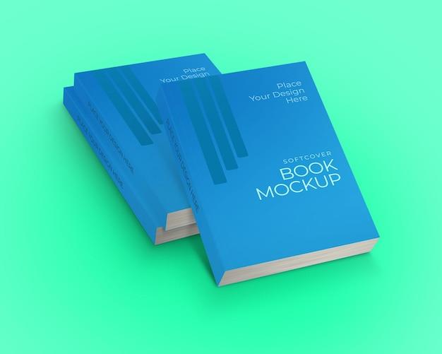Maqueta de libro de tapa blanda tres pilas de libros vista oblicua superior aislada sobre fondo verde
