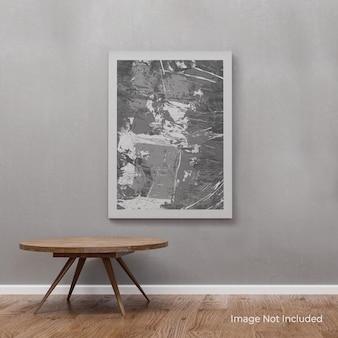 Maqueta de lienzo de retrato colgado en la pared