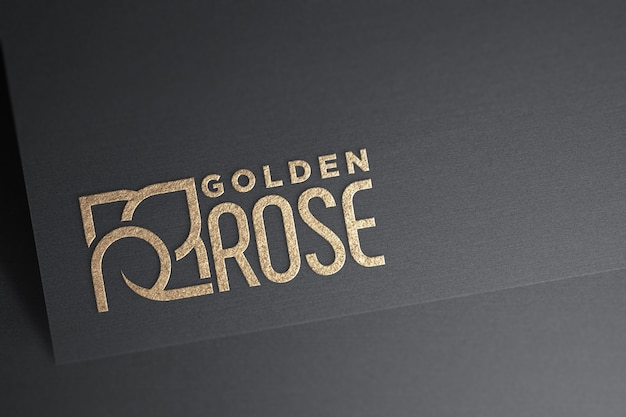 Maqueta de logo dorado sobre papel oscuro
