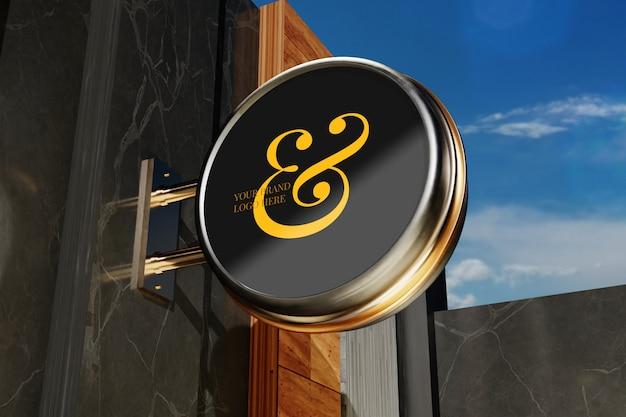 Maqueta del logo en el edificio exterior