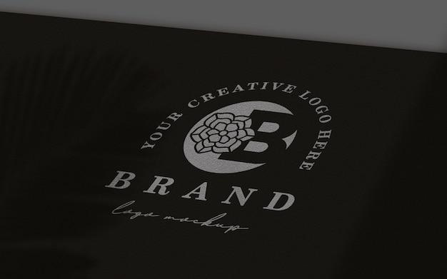 Maqueta de logo de papel negro en perspectiva