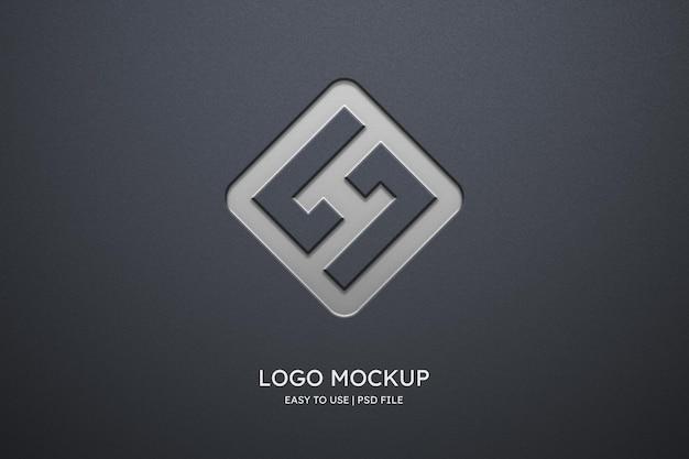 Maqueta de logo en pared gris