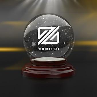 Maqueta de logotipo con bola de nieve navideña