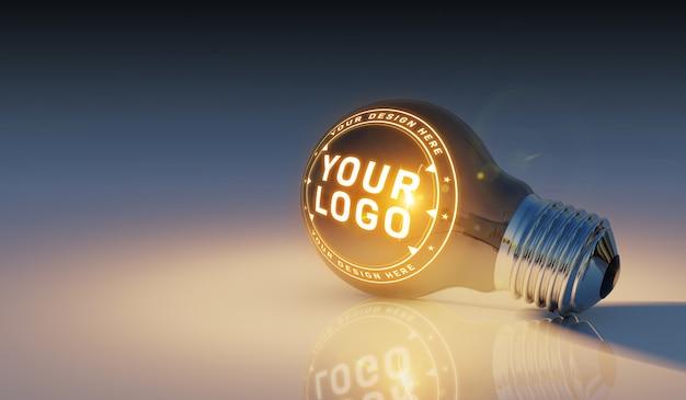 Una maqueta de logotipo de una bombilla brillante tendido en el suelo