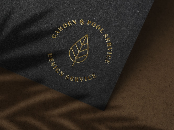 maqueta de logotipo dorado de lujo en textura de papel negro
