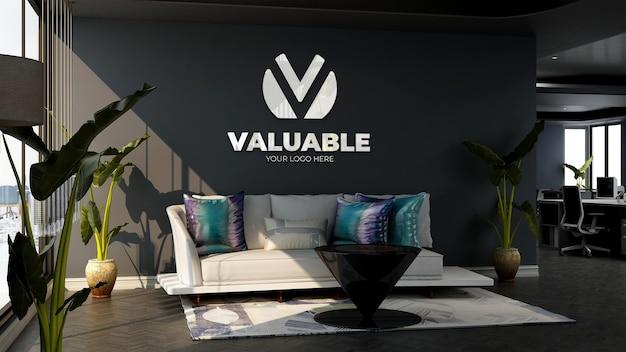 Maqueta del logotipo de la empresa 3d en la sala de espera del vestíbulo de la oficina con sofá y diseño minimalista