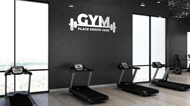 Maqueta de logotipo de gimnasio 3d en el área de fitness con la pared negra para atleta