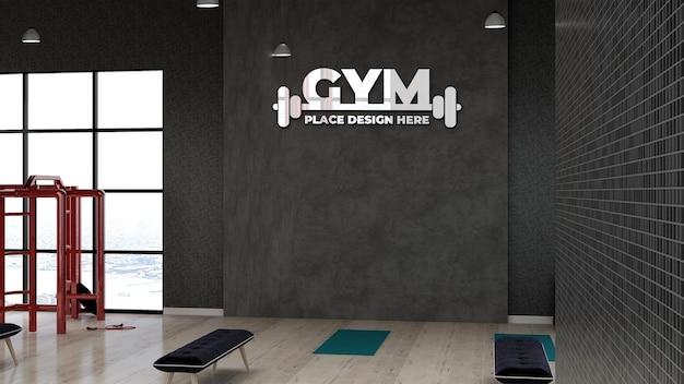 Maqueta de logotipo de gimnasio 3d en la sala de fitness para entrenamiento de atletas con pared negra de piedra