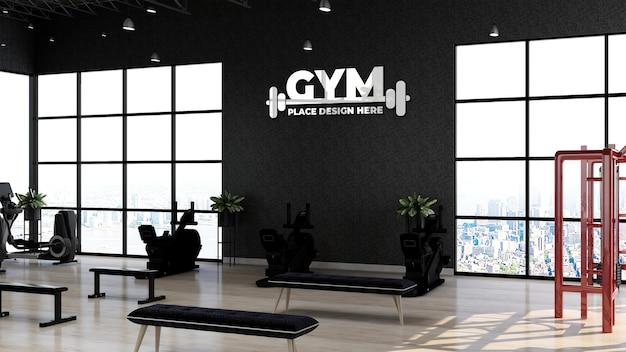 Maqueta de logotipo de gimnasio plateado realista en el área del gimnasio para la sala de entrenamiento de atletas