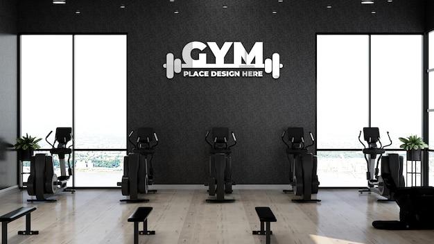 Maqueta de logotipo de gimnasio realista en el área de fitness para ejercicio de atleta
