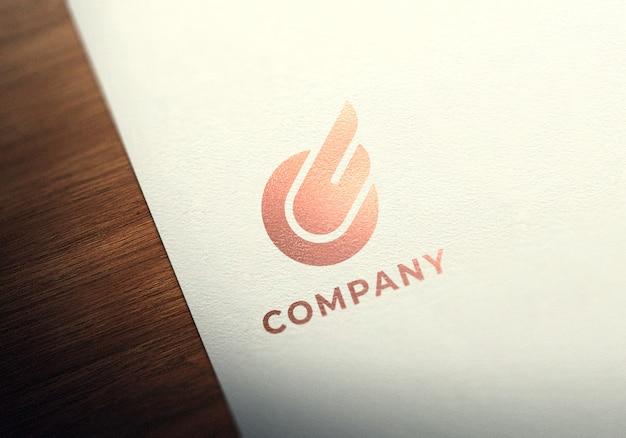 Maqueta de logotipo de lámina de oro rosa en estilo de papel con textura