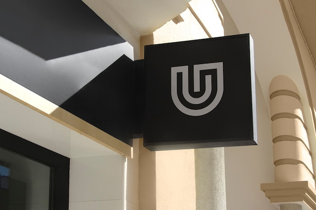 Maqueta de logotipo letrero de pared colgante negro