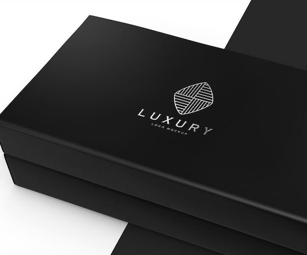 Maqueta de logotipo de lujo en caja negra