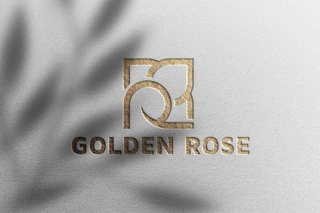 Maqueta de logotipo de lujo sobre papel blanco