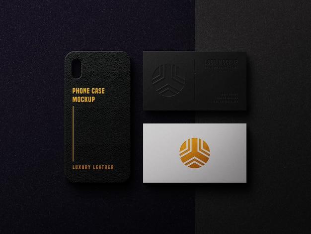 Maqueta de logotipo de lujo en tarjeta de visita y caja del teléfono