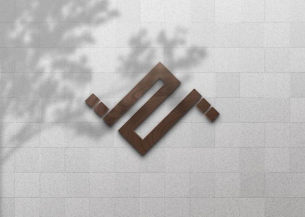 Maqueta de logotipo de madera 3d en pared blanca con sombra de árbol