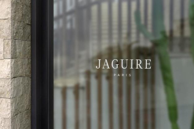 Maqueta de logotipo moderno letrero de ventana pared de piedra