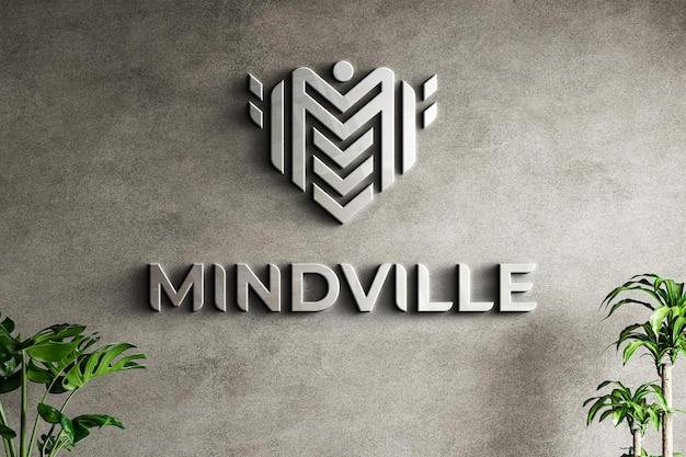Maqueta de logotipo en pared blanca con textura de grunge