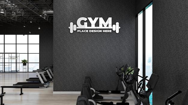 Maqueta de logotipo de pared de gimnasio en la sala de fitness o gimnasio de atleta con pared negra