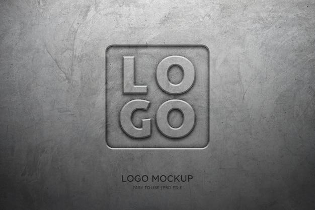 Maqueta de logotipo en la pared de hormigón