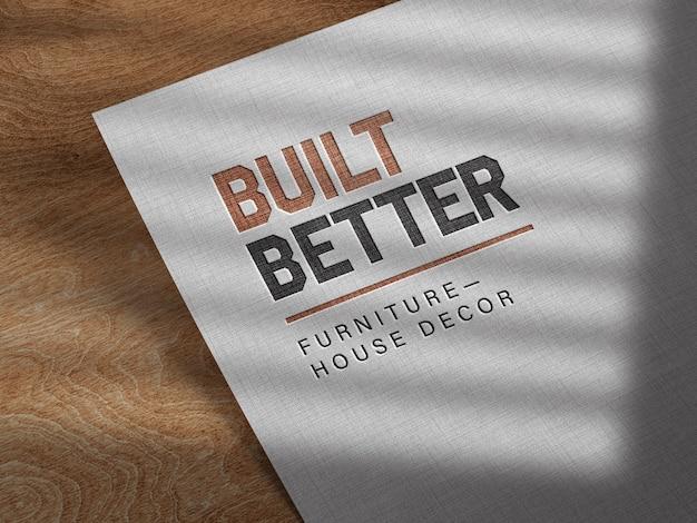 Maqueta de logotipo en relieve sobre papel de lino