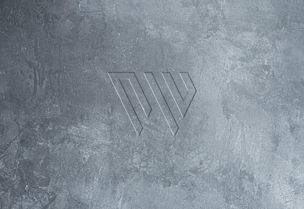 Maqueta de logotipo en relieve de textura de muro de hormigón fresco