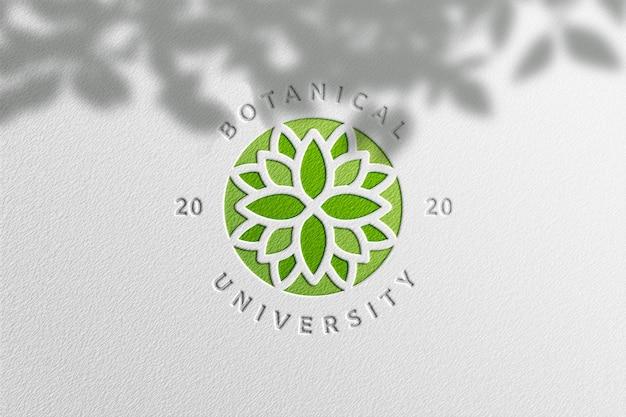 Maqueta de logotipo simple en papel blanco con sombra de planta