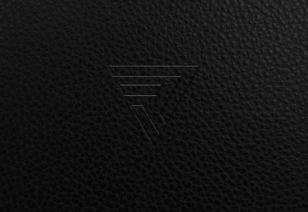 Maqueta de logotipo de textura de cuero oscuro