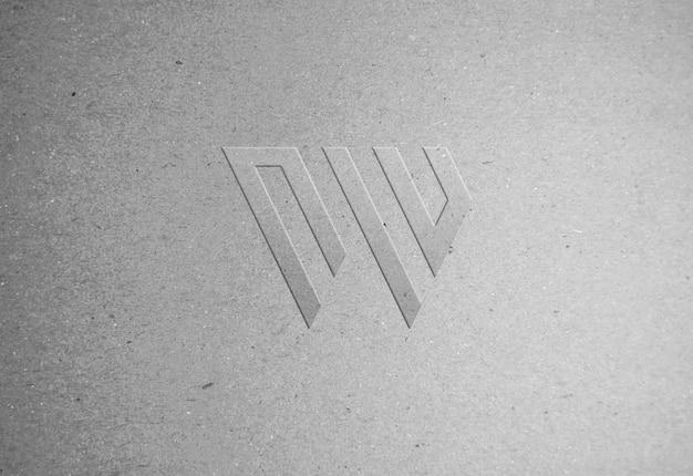 Maqueta de logotipo de textura de papel reciclado en relieve