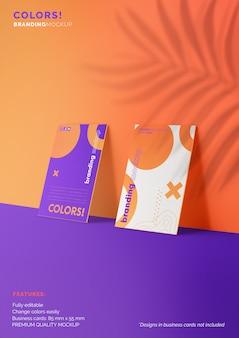 Maqueta de marca editable con dos tarjetas de visita