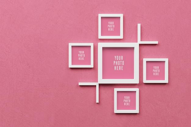 Maqueta de marco 3d sobre fondo de pared rosa