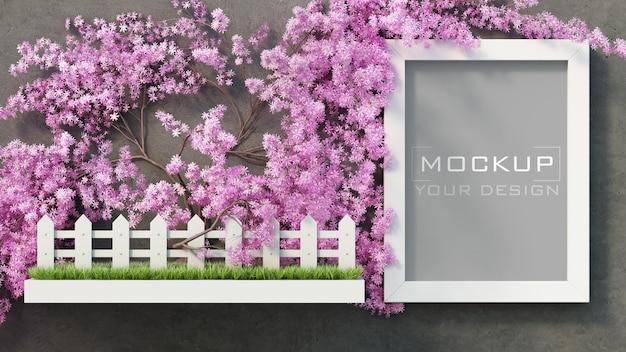 Maqueta de marco blanco en muro de hormigón con árbol de flores rosadas