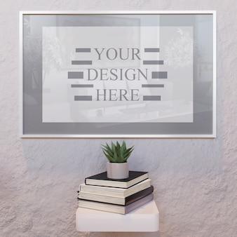 Maqueta de marco blanco vertical en la pared con libros sobre el escritorio