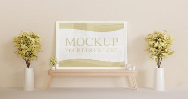 Maqueta de marco blanco vertical de pie sobre el escritorio de pared de madera con plantas decorativas