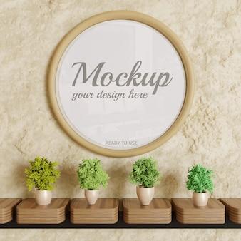 Maqueta de marco brillante circular en pared con decoración de plantas