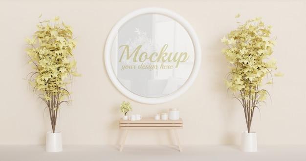 Maqueta de marco de círculo blanco en la pared con un par de plantas decorativas