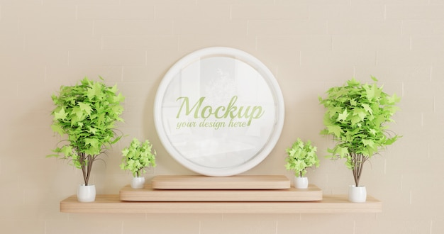 Maqueta de marco de círculo blanco de pie en el escritorio de pared de madera con plantas decorativas